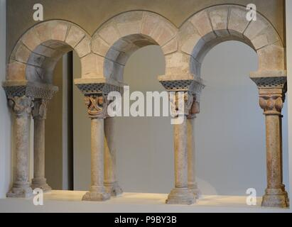 Cloister gallery of Monastery of St Pere of Puelles, Barcelona, Spain. After 1187. Romanesque. Anonymous. Montjuic stone. Museographic presentation. National Art Museum of Catalonia. Barcelona. Catalonia. Spain. - Stock Photo