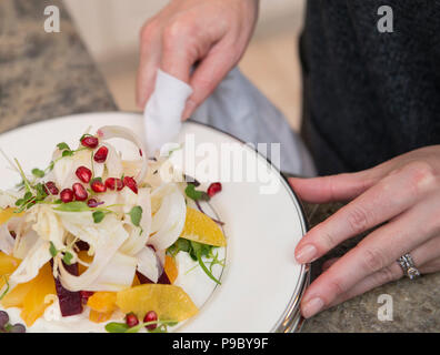 A woman preparing a fennel salad for a holiday menu. - Stock Photo