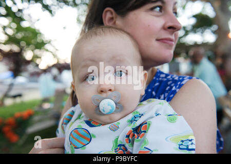 A baby with a pacifier. - Stock Photo