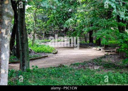 A path winds through a park in Machida, Tokyo - Stock Photo