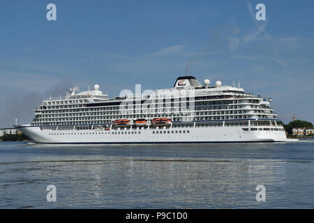 Cruise Ship Viking Star heads down the River Thames after making a port call in London - Stock Photo
