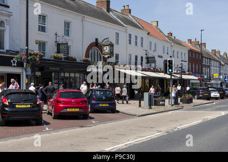 Northallerton High Street on a hot sunny Summer's day; North Yorkshire, UK - Stock Photo