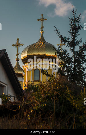 a small church after renovation with golden dome - Stock Photo