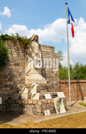 Statue, monument and French National flag in the Commonwealth War Graves Commission graveyard in Douai, Nord, Picardy, - Stock Photo