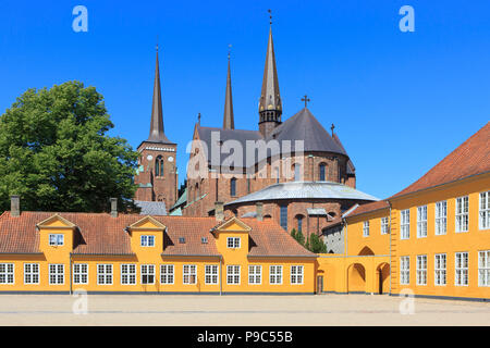 The 12th-century brick Gothic Roskilde Cathedral seen from the Bishop's House in Roskilde, Denmark - Stock Photo