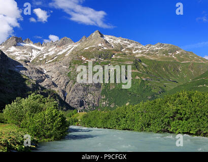 Serpentine road connecting alpine passes Furka and Grimsel in Swiss Alps with Rhone River on the foreground, Europe - Stock Photo