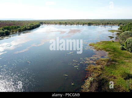 Aerial view of Lake Jabiru in dry season. Jabiru is the main township in Kakadu National Park. Green grass around the lake. - Stock Photo