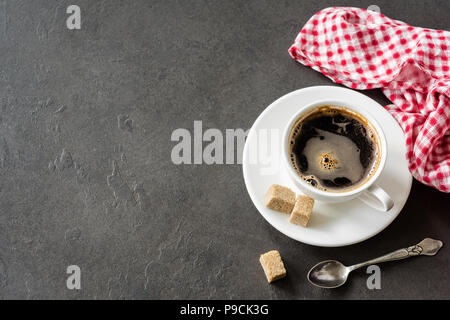 Cup of coffee on concrete background with copy space for text. Business, breakfast, coffee break concept - Stock Photo