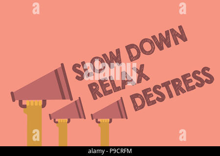 Writing note showing Slow Down Relax Destress. Business photo showcasing calming bring happiness and put you in good mood Hands holding megaphones lou - Stock Photo