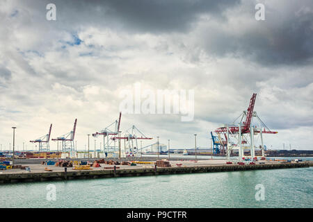 Cranes on the docks at the industrial port of Dunkirk, France, Europe - Stock Photo
