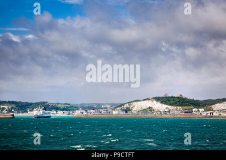 Car ferries, the harbour wall and Dover Castle above the ferry port of Dover, Kent, England, UK - Stock Photo
