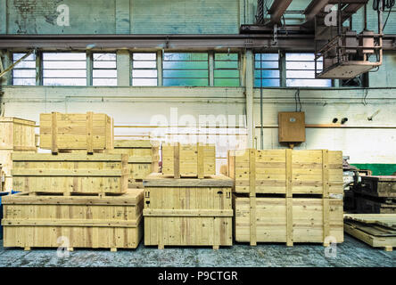 Wooden packing crates in an old warehouse, England, UK - Stock Photo