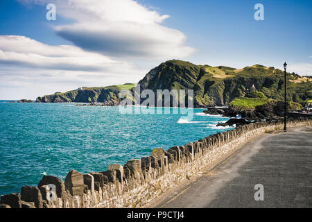 Footpath along the rocky coast of Ilfracombe, North Devon, England, UK - Stock Photo