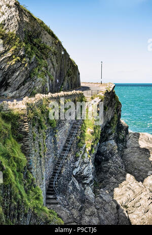 Footpath along the rocky coastline of Ilfracombe, North Devon, England, UK - Stock Photo