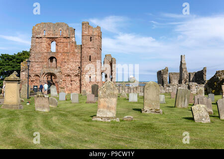 The remains of the famous monastry.  The Holy Island of Lindisfarne, also known simply as Holy Island - Stock Photo