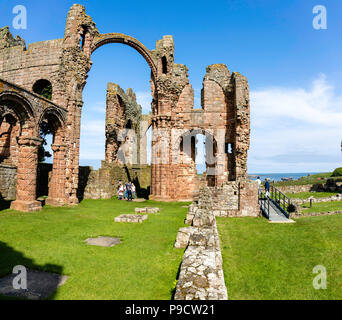 The remains of the famous monastery.  The Holy Island of Lindisfarne, also known simply as Holy Island - Stock Photo