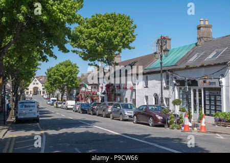 Shopping street in Malahide, a trendy affluent coastal town in Fingal, Leinster, County Dublin, Ireland, Europe - Stock Photo