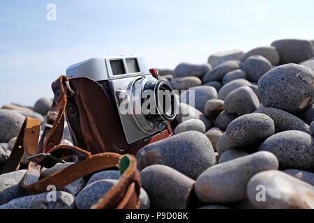 vintage retro 35mm film rangefinder camera in brown leather case - Stock Photo