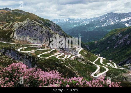 Gotthard pass with the historic curvy road on a summer cloudy day in Switzerland - Stock Photo
