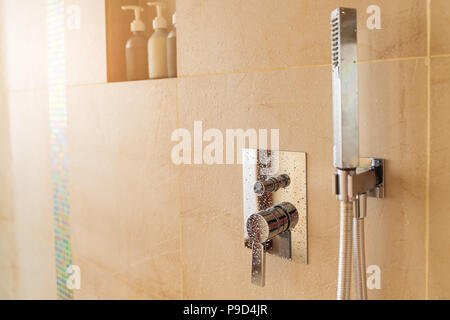 Close up shower on bathroom background, interior room concept. - Stock Photo