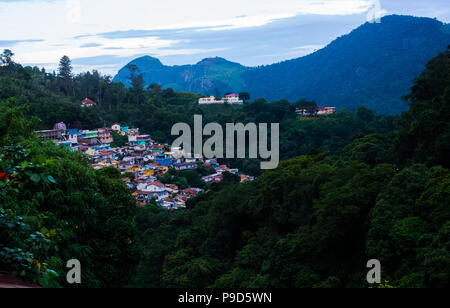 View of colourful houses in Coonoor Town, India - Stock Photo