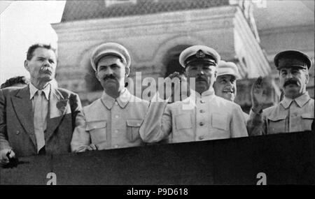 Maxim Gorky, Lazar Kaganovich, Kliment Voroshilov, Joseph Stalin on Lenin's Mausoleum Tribune. Museum: State Museum of the Political History of Russia, St. Petersburg. - Stock Photo