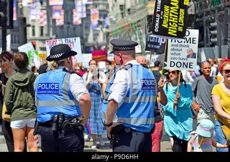 Metropolitan Police Liaison Officers at an anti-Trump march in central London, England, UK. 13th July 2018 - Stock Photo
