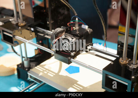 3d printer creating a new plastic object close-up. 3 dimensional printing process on innovative electronic equipment - Stock Photo