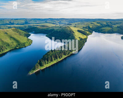 An aerial landscape of the lake near the Llyn Clywedog Dam, Llanidloes, Wales, UK - Stock Photo