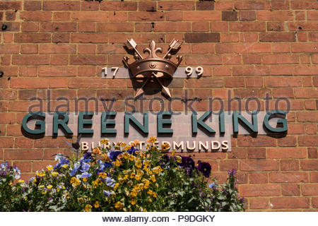 Date and emblem sign on the wall outside a Greene King Pub in Marlborough, Wiltshire, England, UK - Stock Photo