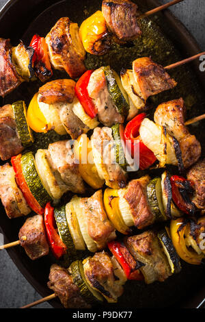 Grilled shish kebab or shashlik with vegetables  on skewers. Barbeque meat dish. Close up. - Stock Photo
