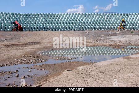Bales with garbage. Plastic bales with waste for recycle on a mountain and blue sky background. Packing trash.  Environment and plastic pollution. Cli - Stock Photo