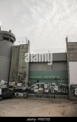 Tank gate as part of the separation barrier between the occupied palestinian territory and Israel, featuring a high security watchtower - Stock Photo