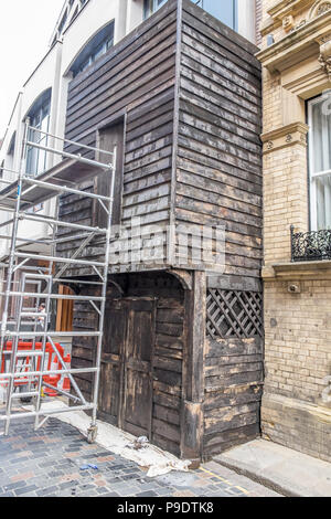 A film set, setting up and building false fronts to shops and windows in hull - Stock Photo