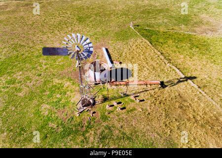 Windmill in australia on remote cattle farm. - Stock Photo