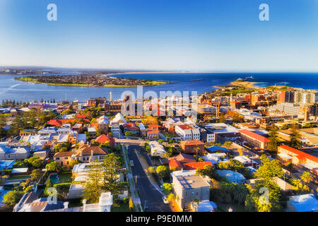 City of Newcastle in Australia north from Sydney - Hunter river mouth to Pacific ocean. CBD of industrial hub and sea port with local streets and hous - Stock Photo