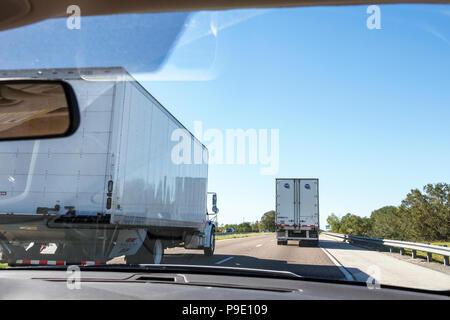 Florida Winter Park Florida Turnpike toll road highway semi-tractor trailer trucks lorries traffic lanes driving window windshield view - Stock Photo