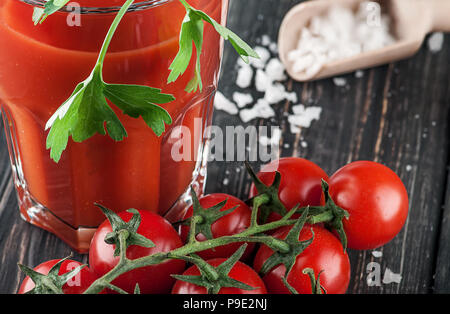 Closeup of tomato juice and cherry tomatoes - Stock Photo