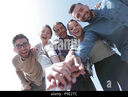 creative team,with hands clasped together - Stock Photo