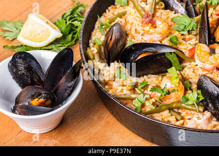 Spanish cuisine, paella with seafood and vegetables - Stock Photo