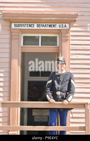 Soldier outside Subsistence Department Fort Mackinac, 1 of only 2 Revolutionary Forts remaining in USA, Mackinac Island on Lake Huron, Michigan, USA - Stock Photo