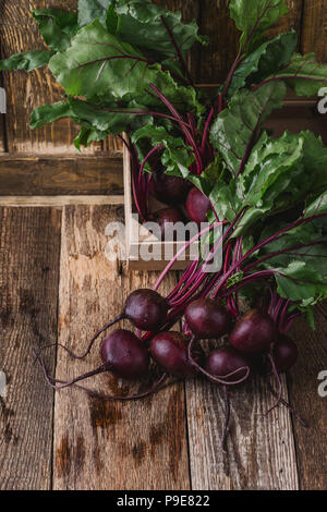 Fresh homegrown beetroots on wooden rustic table - Stock Photo