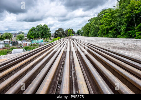 rail tracks disappearing into distance - Stock Photo