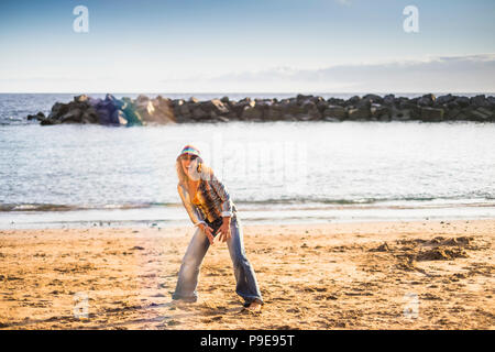 happy freedom crazy middle age woman jump on the beach for happiness and joyfun life outdoor vacation summer ocean and beach concept. fashion hippy cl - Stock Photo