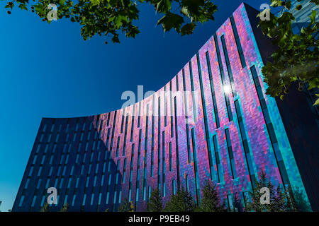 London, UK - JULY 15 2018: The ExCeL Center, an exhibitions and international convention centre Bright and colourful facade of the Aloft Hotel - Stock Photo