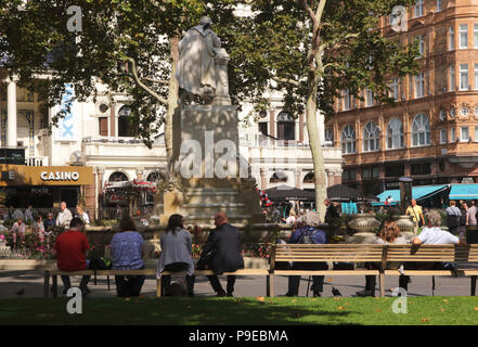People relaxing near the William Shakespeare Statue Leicester Square London September 2017 - Stock Photo