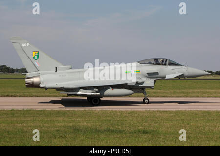 RAF Eurofighter Typhoon FGR4 from 3 Squadron taxiing on the Southern taxiway at RAF Coningsby during routine training. - Stock Photo