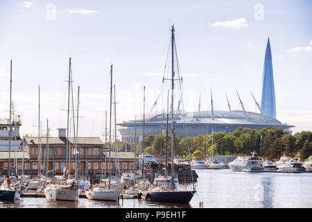 SAINT PETERSBURG. RUSSIA - JULY 03 2018. Marina with yachts and distant view of Krestovsky Stadium (Zenit arena) and Gazprom tower - Stock Photo