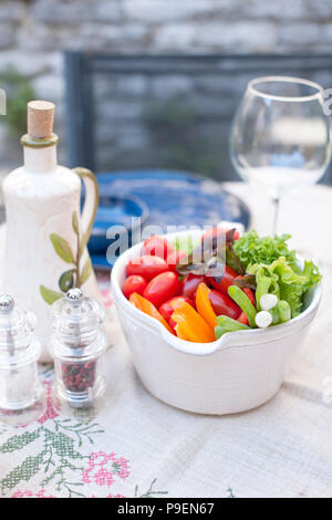 Vegetable salad in a ceramic plate. Lunch in the open air. Healthy food. Copy space - Stock Photo