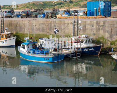 Commercial fishing boats moored in Padstow harbour Cornwall UK in evening sunlight - Stock Photo